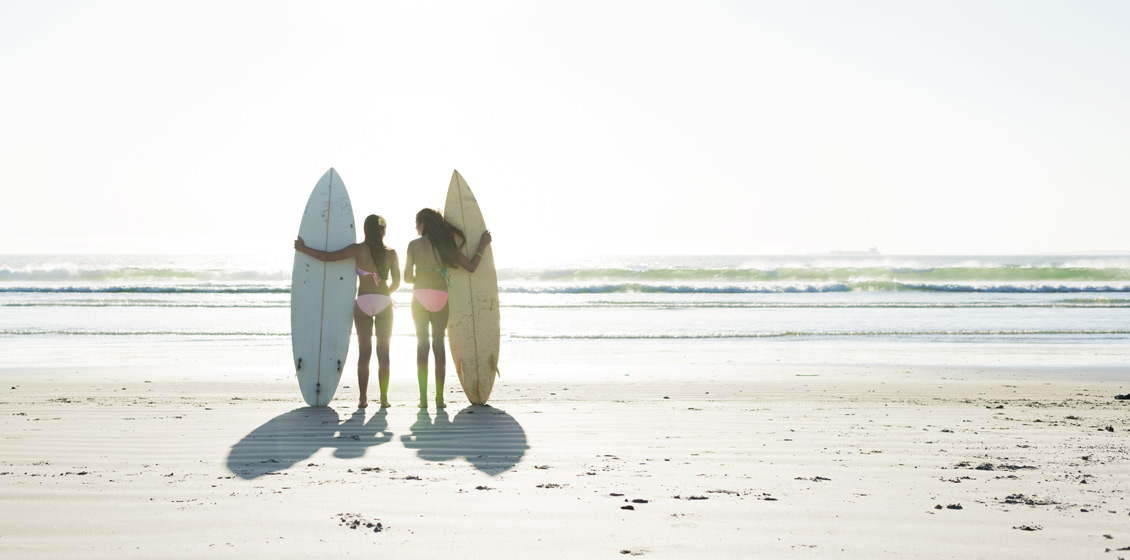 Two Girls with Surfboards